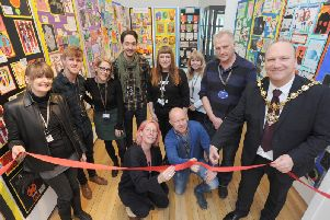 Photograph caption: Mayor of Blackpool Councillor Gary Coleman opening the Young Seasiders Exhibition with the team from Blackpool & The Fylde College.