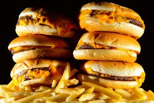 """Junk food adverts on TV and online could be banned before 9pm as part of Government plans to fight the """"epidemic"""" of childhood obesity. Photo: Dominic Lipinski/PA Wire"""
