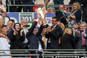 Gary Bowyer lifting the League Two play-off final winners trophy at Wembley