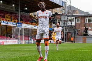 Armand Gnanduillet celebrates the second of his superbly-taken headers