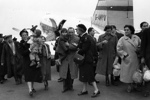 Hungarian refugees arrive in the UK, on November 17, 1956 and are met at Blackbushe Airport by Social Workers. (Photo: Keystone/Getty Images)