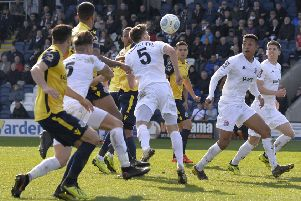 Jordan Tunnicliffe heads AFC Fylde on level terms    Picture: Steve McLellan