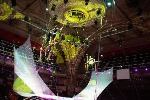 A stunning trapeze act in the new carnival show at the circus