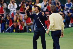 Nick Price of Zimbabwe looks on as Spanish golfer Severiano Ballesteros (left) celebrates his final putt on the 18th green during the Open Championship at the Royal Lytham and St Annes Golf Club, July 1988. Ballesteros went on to win the tournament. (Pic: Getty Images)