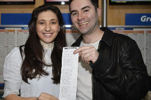 Craig and fiancee Harriet with his winning betting slip.
