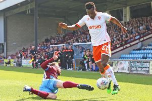 Marc Bola in action at Glanford Park