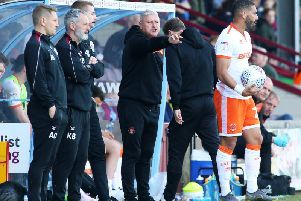 Blackpool manager Terry McPhillips in the dugout at Glanford Park
