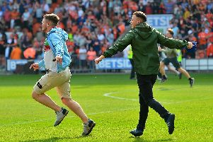 A small number of fans invaded the pitch to celebrate Blackpool's late goal