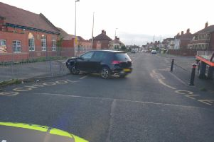 The Golf hit railings outside Baines Endowed School on Penrose Avenue. Pic: Lancs Road Police