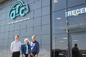 Flde Coast ARC's new building at the airport enterprise zone. Pictured are, left to right, Dane Hyland, bodyshop manager, Linda Hyland, HR director and Dave Hyland, managing director