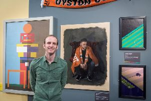 Gary Armer with his portrait Not a Penny More at the National Football Museum
