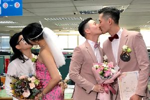 Hundreds of same-sex couples in Taiwan are rushing to the household registration office on the first day that a landmark decision to legalize same-sex marriage has taken effect.