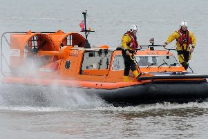 The hovercraft plucked the man off a sandbank