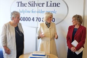The Duchess of Cornwall meets CEO Sophie Andrews and founder Esther Rantzen at the offices of The Silver Line.