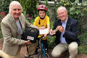 Rotary Lytham President John Edwards (right) and Rotarian Herbert Chatters present Austin Brennand with a cheque towards the youngster's appeal to fund a defibrillator for Ansdell
