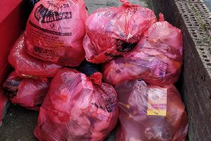 A pile of red bin bags left off Dickson Road, Blackpool town centre, on Monday, June 17, 2019