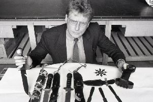 Chief trading standards officer Jim Potts with a display of deadly weapons