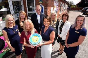 Hayley Howarth, Melissa Hoyle, David Hoyle, Sophie Mellor, deputy mayoress of Wyre Colette Birch and Faye McCulloch with founder and director Jackie Hoyle and operations manager Catherine Rosenfield with the cake