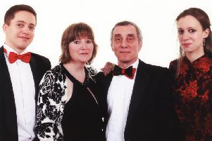 Ros Howell from Wrea Green, pictured  with her husband Dave, son James and daughter Deborah, raised more than 2,000 for Childrens Liver Disease Foundation at her birthday party
