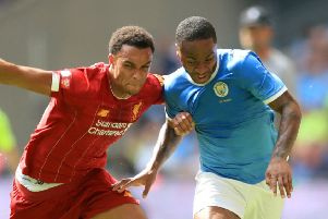 Liverpool's Trent Alexander-Arnold (left) and Manchester City's Raheem Sterling battle for the ball during the Community Shield match at Wembley Stadium (photo: PA)