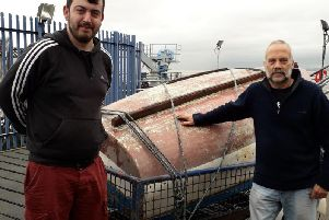 James Walker and Phil Smith, with their boat My Girls