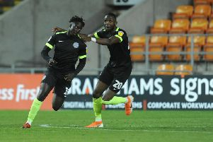 Virgil Gomis celebrates after scoring Macclesfield's second of the game