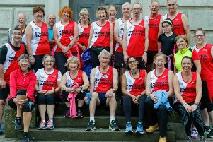 MIke Walsh (front centre) with proud clubmates from Thornton Cleveleys Running Club Picture: ALEX SHAW