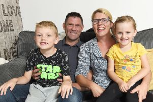 Vanessa Jones is pictured with husband Billy Jones and children William, six and four-year-old Beaux