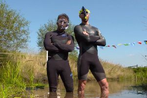 Neil Rutter and Inside Out West presenter Sabet Choudhury taking part in the annual bog snorkelling world championships