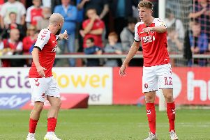 Paddy Madden and Jimmy Dunne have a difference of opinion over Oxford's goal