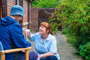 Pictured is Fiona Claughton, senior healthcare assistant, chatting to a patient at the Wellbeing Centre at Saint Catherines.