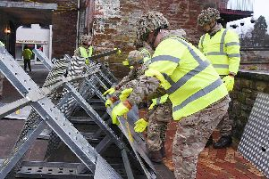 Soldiers from 2LANCS helping to set up flood defences in Appleby as the Army has been called in to support efforts to protect flood-hit areas of Cumbria amid fears that more heavy rain will fall.