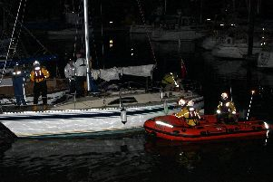 The inshore lifeboat and the yacht. Picture by RNLI.