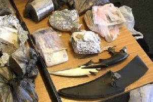 Cash, zombie knives and an extendable baton were found by police when they raided a property in Bridlington.