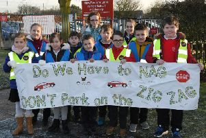 New Pasture Lane School has put up five banners to encourage drivers to think about where they park their cars.