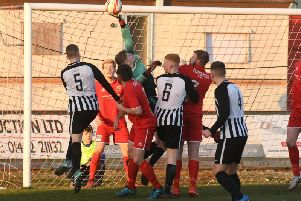 Tom Jackson makes a save for Brid Town