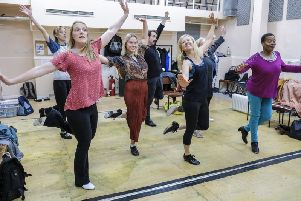 The cast in rehearsal