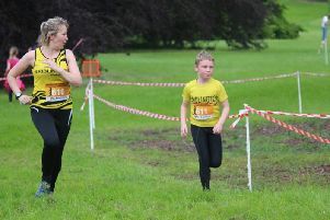 Brid Road Runners Vicki Ellerker looks across as son James pips her to the finish of the Sledmere 3km Trail Taster                       ''PICTURES BY TCF PHOTOGRAPHY