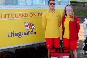 RNLI lifeguards Aaron Miles and Ceri Boddy. Photo by Andy Brompton.