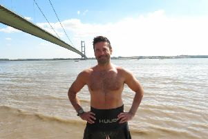 Richard Royal is pictured close to the Humber Bridge, ahead of his record-breaking swim.