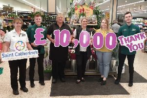 Morrison's staff presents the cheque to Saint Catherine's Hospice.