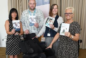 NRS Health Care - Lisa Walker, Neil Hopper,Amanda Rea and Sharon Martin pictured with one of latest chairs on the market