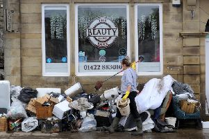 Flooding aftermath after Storm Ciara at Mytholmroyd. Staff at the Beauty Bank clear up after the flood devastation. Picture by Simon Hulme