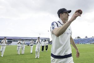 Yorkshire's Matthew Fisher is congratulated on taking 5 wickets in the innings against Warwickshire.
