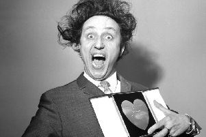 Sir Ken Dodd, who has died aged 90, with his award for Show Business Personality of the Year, presented to him at the Variety Club's luncheon in 1966.