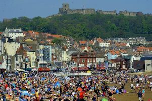 People enjoy the hot summer sun on the beach at South Bay in Scarborough on Monday. Picture by Simon Hulme