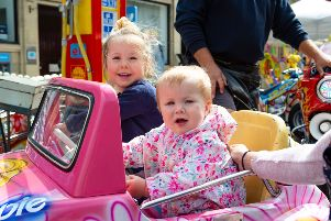 Olivia and Emilia Burnhill, at  Brighouse Artisan Market in the town centre