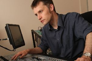 Calrec's marketing manager Kevin Emmott at one of the company's audio consoles.