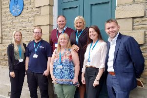 James Howard (back left) with the Yorkshire Payments senior team outside the new office on Bethel Street