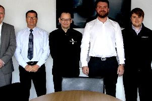 Damian (centre wearing black top) with some of his colleagues